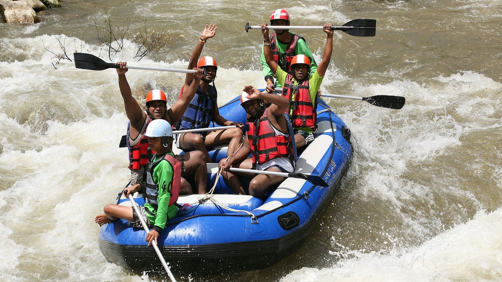 Show item 2 of 6. whitewater rafters cheering in Phuket