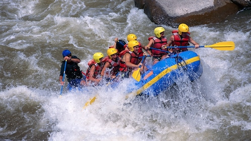 whitewater rafters fighting strong rapids in Phuket