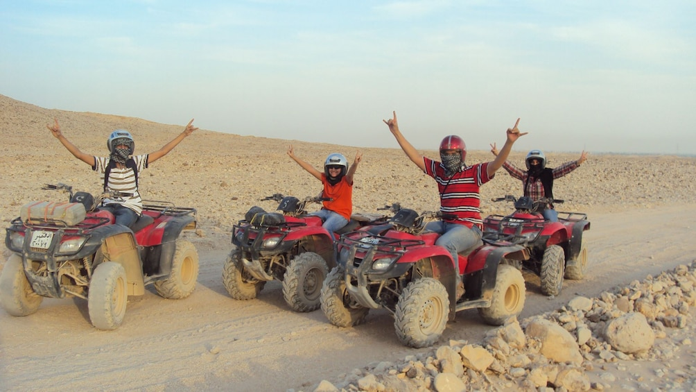 quad bikers cheering from their vehicles at the desert in Sharm el Sheikh