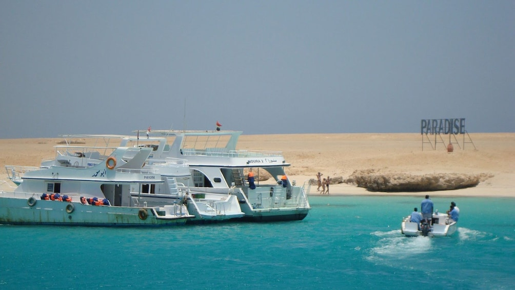Show item 3 of 7. boats near shore in egypt