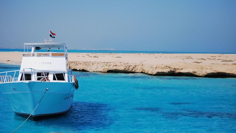 boat in blue water in egypt