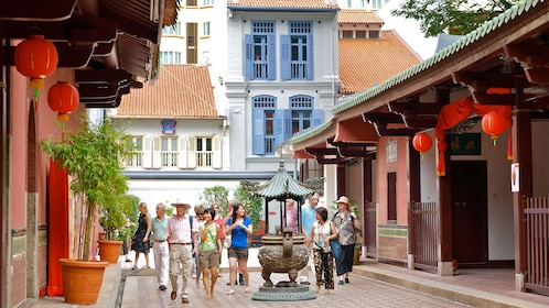 Group walking down the street with Chinese architecture in china town in Singapore