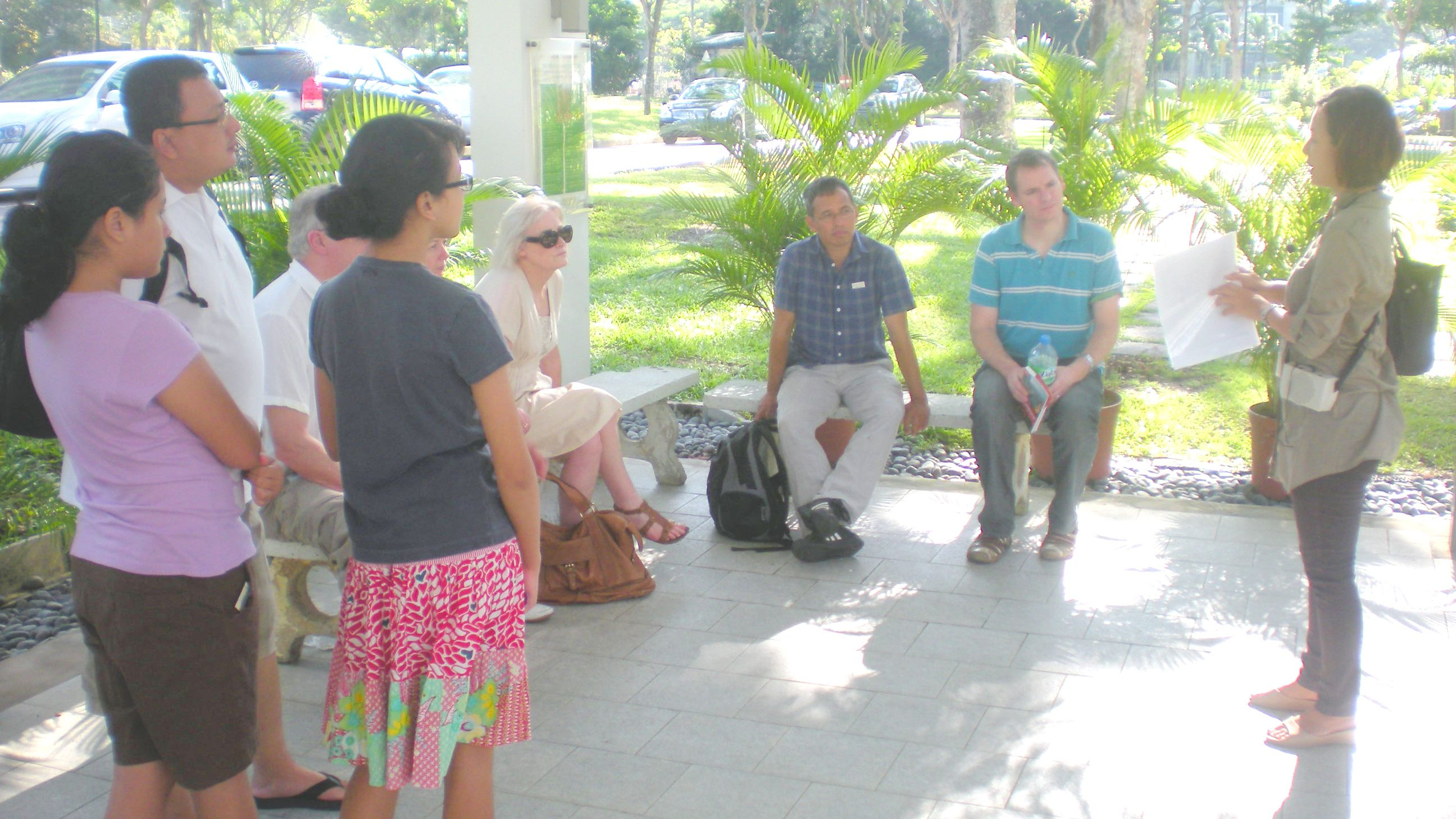 Tour guide talking to group in Singapore