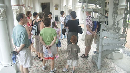 Tour group in CHIJMES next to the spiral stair case in Singapore