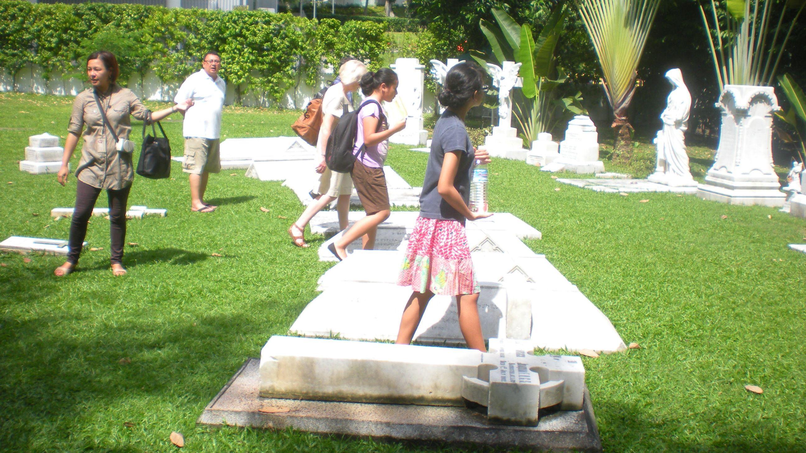 People walking in an grave yard in Singapore