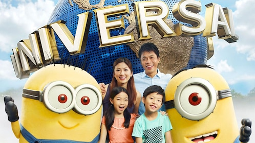 Family posing with minions at universal studio in Singapore