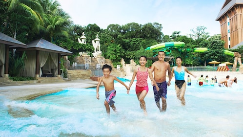 Family in the water at the Adventure Cove waterpark in singapore