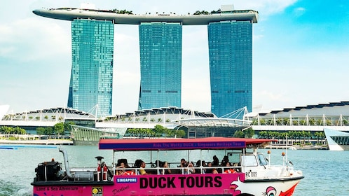 Duck floats by large unique building in Singapore