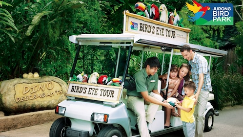 Family on golf cart at the Jurong bird park in singapore