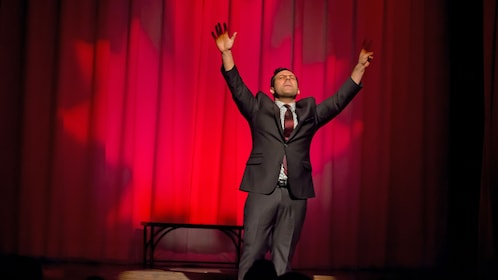 Comedian perform live onstage at Second City Comedy Theatre