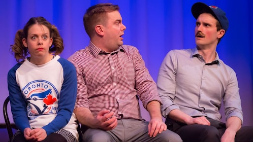 Comedians perform live onstage at Second City Comedy Theatre
