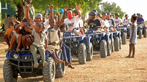 Long lineup of ATVs on the road in La Romana