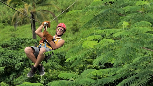 Man zip lining through the jungle in La Romana