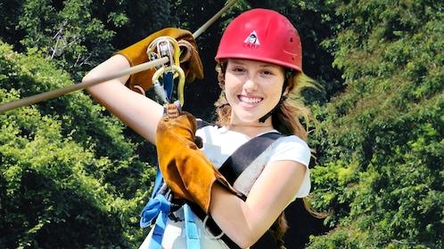 Woman in gear zip lining in La Romana