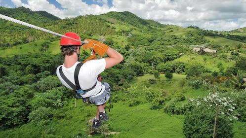 Man in gear zip lining in La Romana