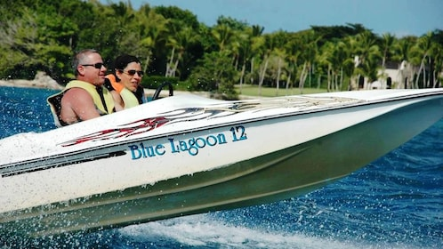 Couple speeding through the water on a boat in La Romana