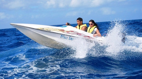 Couple riding on a speedboat in La Romana