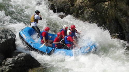 Group of rafters shooting a small gap in the rapids of the Yaque del Norte River