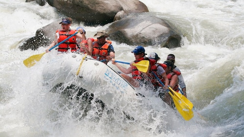 Front of the raft coming out of the water as a group heads down the Yaque del Norte River