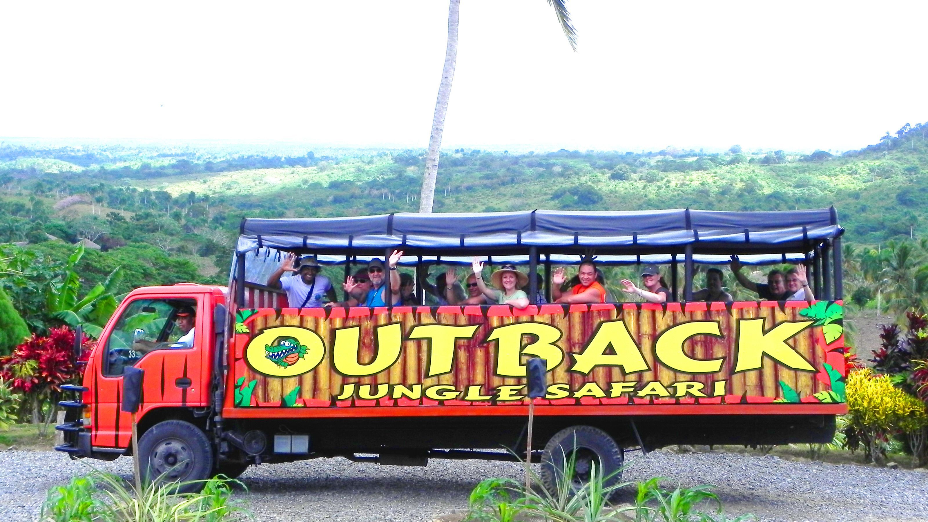 Group waving from the Outback Jungle Safari bus