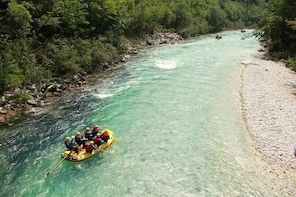 TOP Family Rafting Down the Soca River