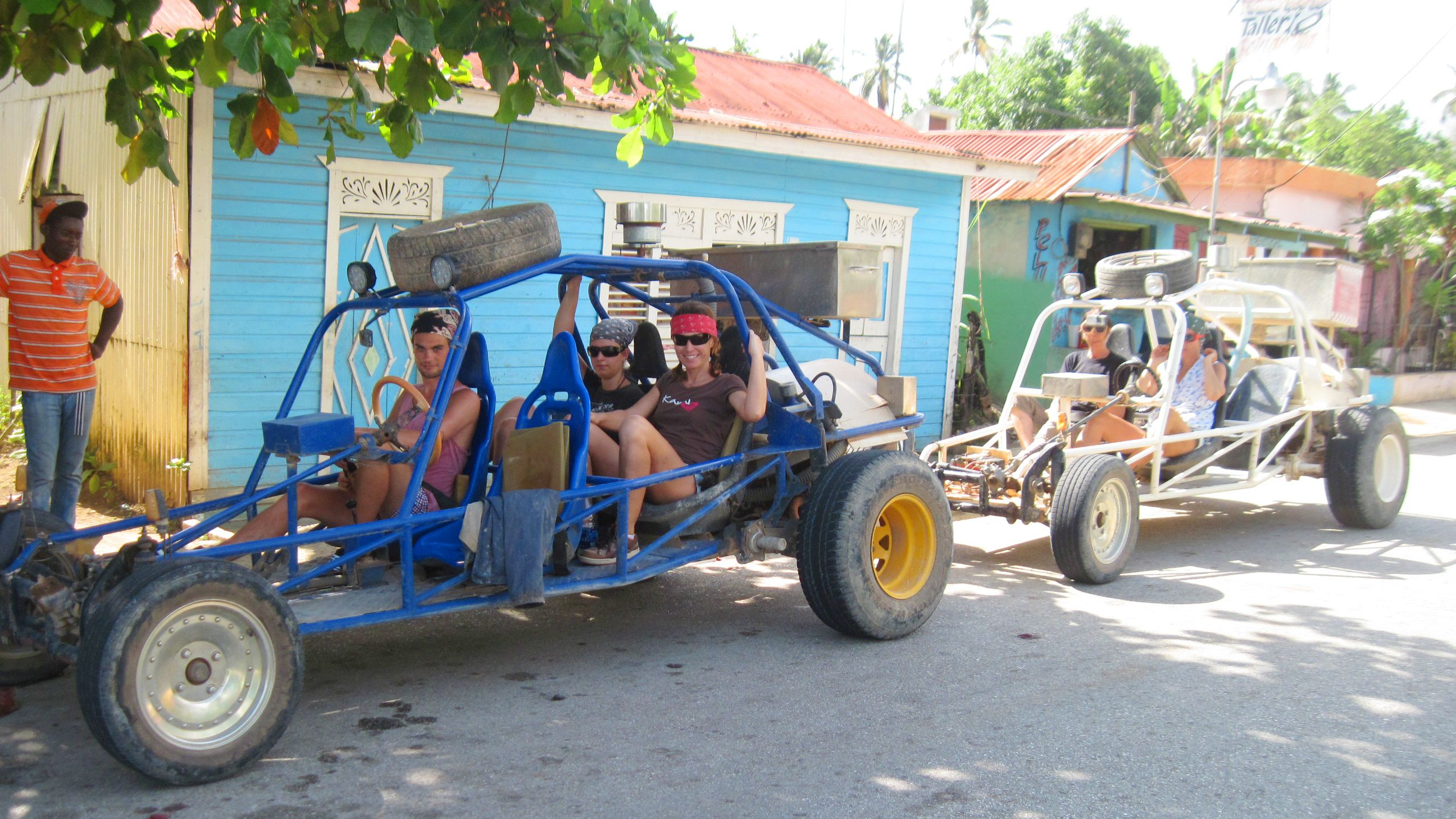 dune buggies parked on road in village in Santo Domingo