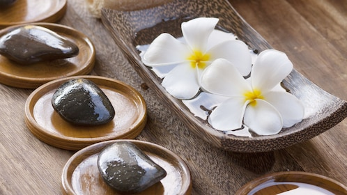 Close-up shot of jasmine flowers and stones