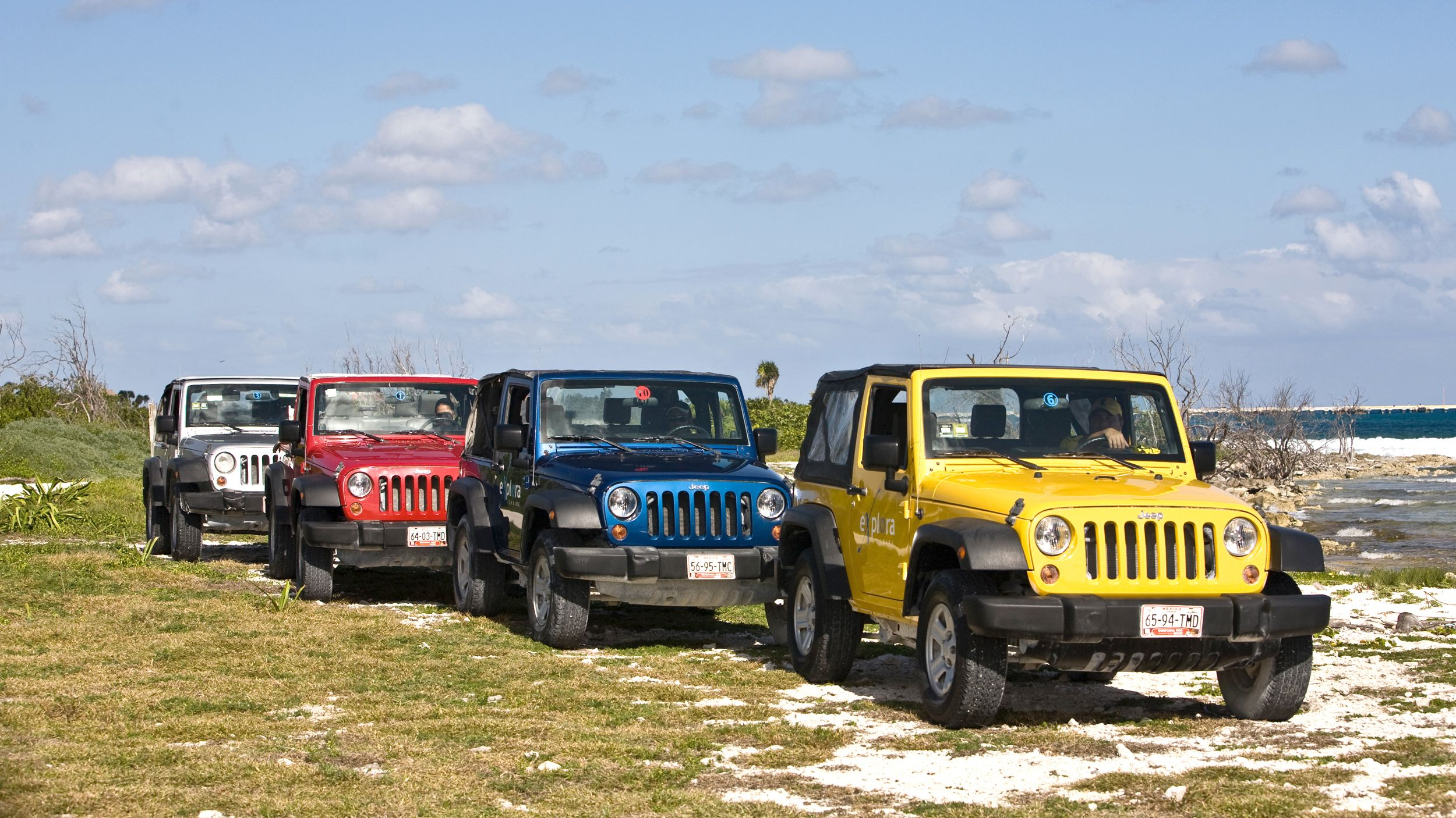 Jeeps driving along the coast in Riviera Maya