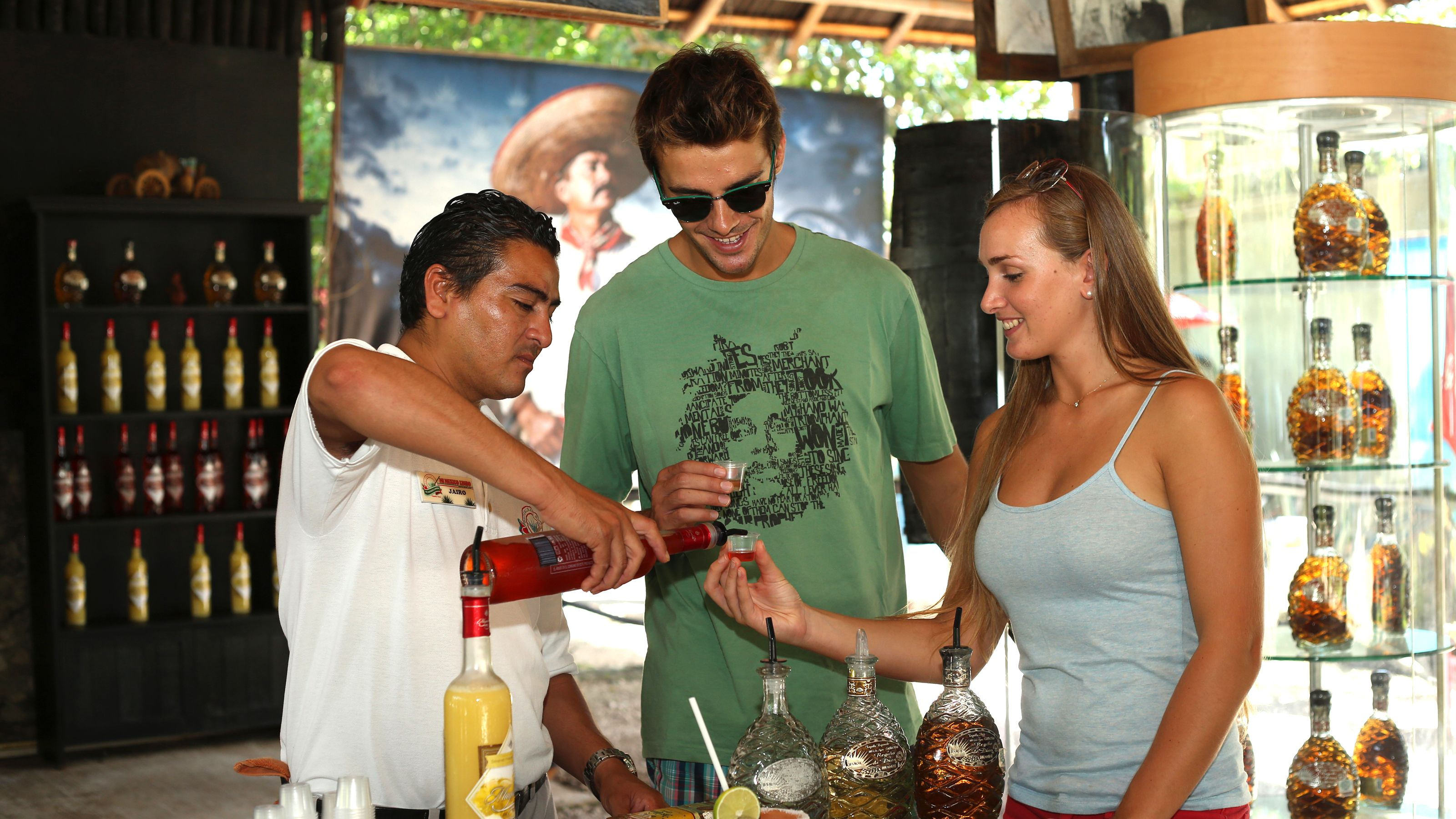 Couple sampling liquor in Riviera Maya