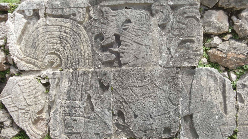 Show item 3 of 7. Stone carvings at the Mayan ruins of Chichen Itza