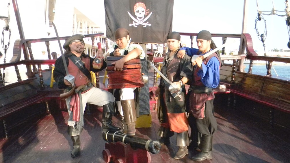 Show item 5 of 5. Pirate crew with cannon on a cruise ship in Cozumel