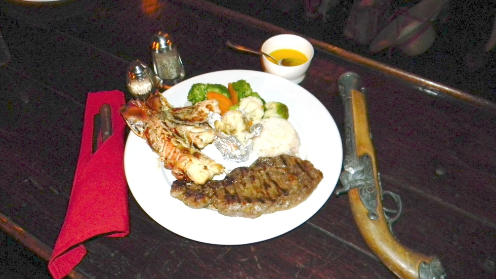 Show item 2 of 5. Lobster and steak dinner on a cruise in Cozumel