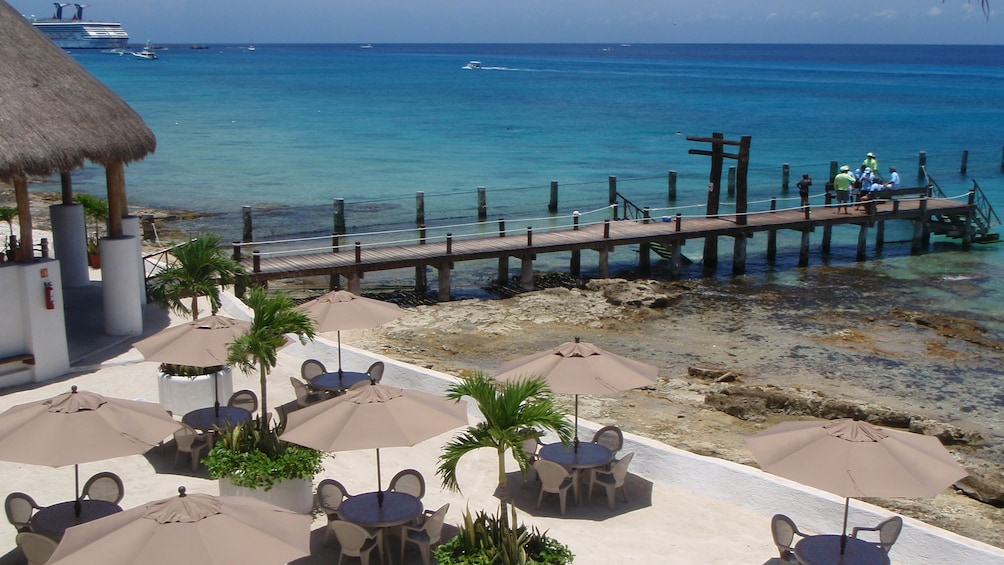 Beachside tables and dock in Cozumel