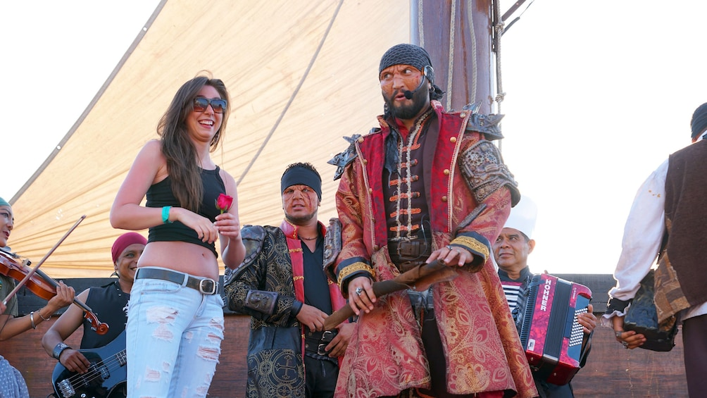 Woman on stage with pirates during Sunset Cruise in Puerto Vallarta