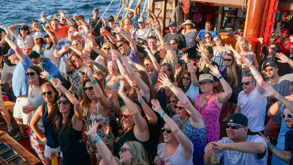 View of audience dancing along to performance during Sunset Cruise in Puerto Vallarta