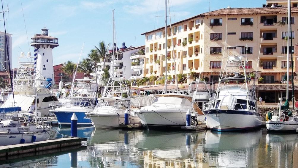 Explore Puerto Vallarta's marina to discover local shops and landmarks