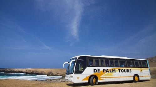 Tour bus parked near the shore in Aruba