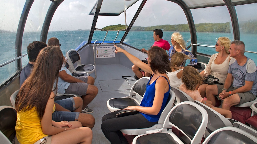 Show item 5 of 10. people on top deck of tour vessel