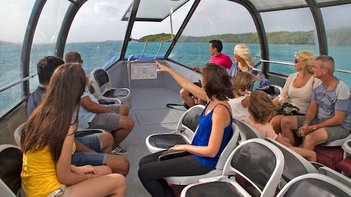 people on top deck of tour vessel