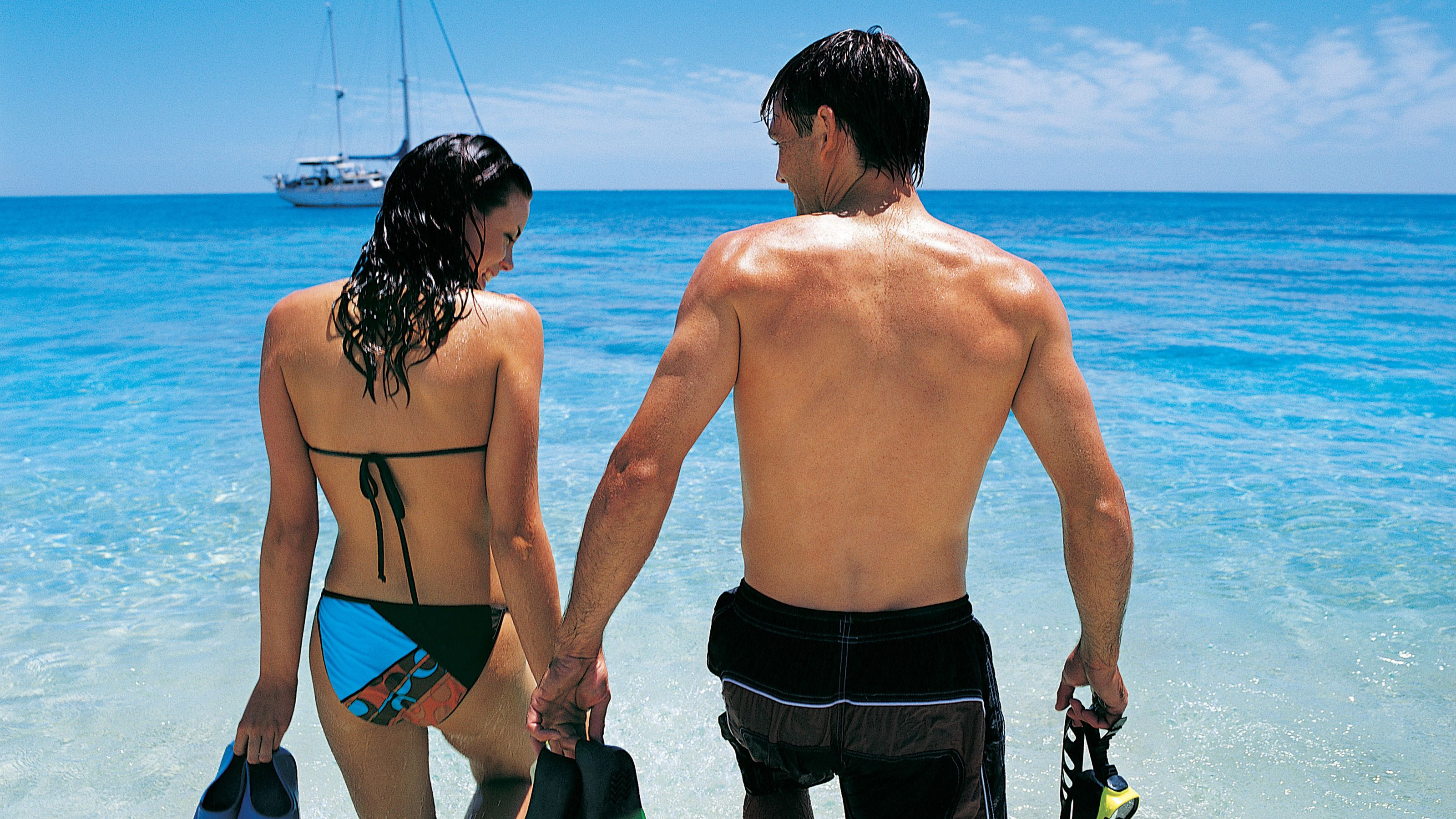 Couple with snorkel gear in Bahamas