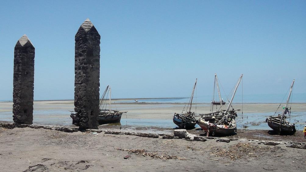 Show item 2 of 5. Pilon structures at the beach in Dar es Salaam