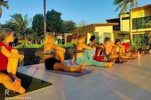 Sunrise yoga class overlooking the beach, the sea & sunrise Idyllic resort.