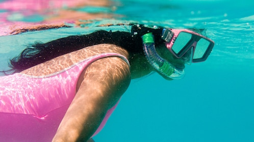 woman snorkeling off the coast of Nevis