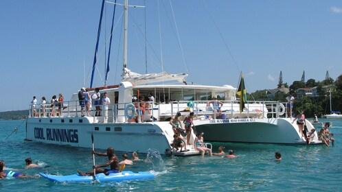 People snorkeling near boat in the Caribbean sea near Jamaica