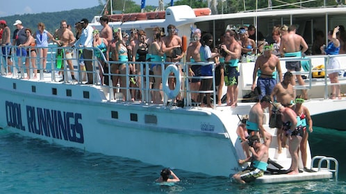 People getting off the boat to go snorkeling in the Caribbean sea near Jamaica