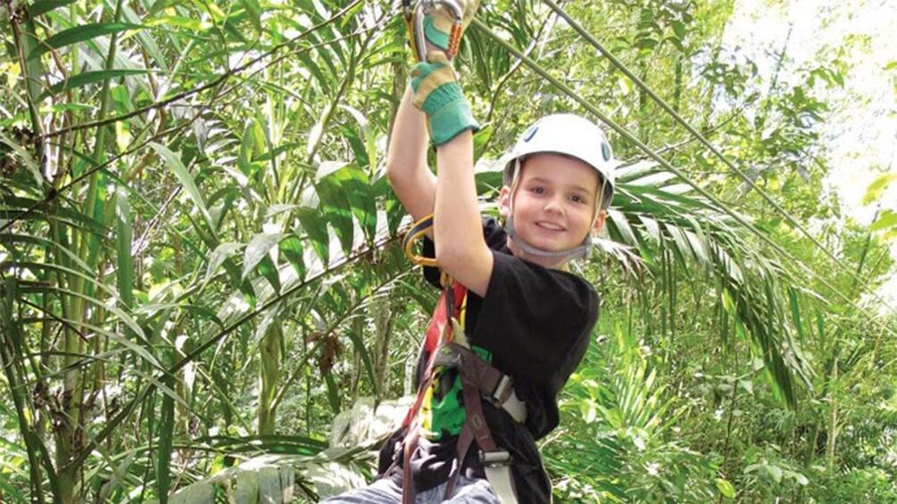 Show item 3 of 7. ziplining kid in jamaica