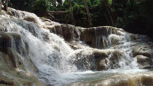 close up of the rocky waterfall in the Dunn river in Jamaica