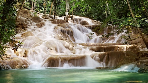 rocky water fall in the dunns river in Jamaica