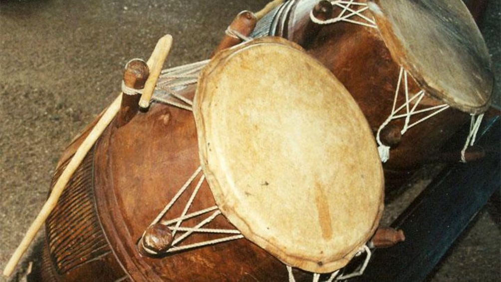 Show item 5 of 10. a talking drum used to play reggae music in jamaica