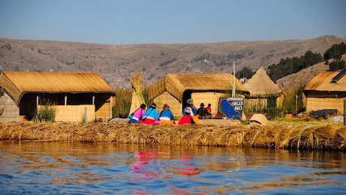 Medium angle of the Uro people on a floating island on Lake Titicaca